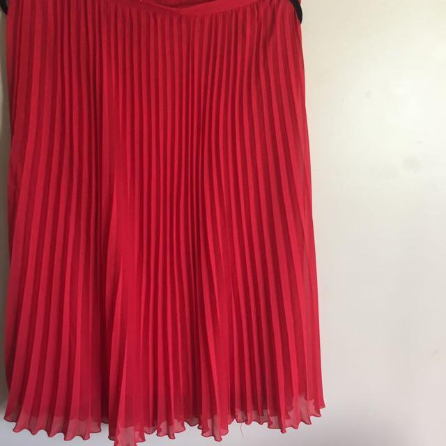 Pleated red chiffon skirt