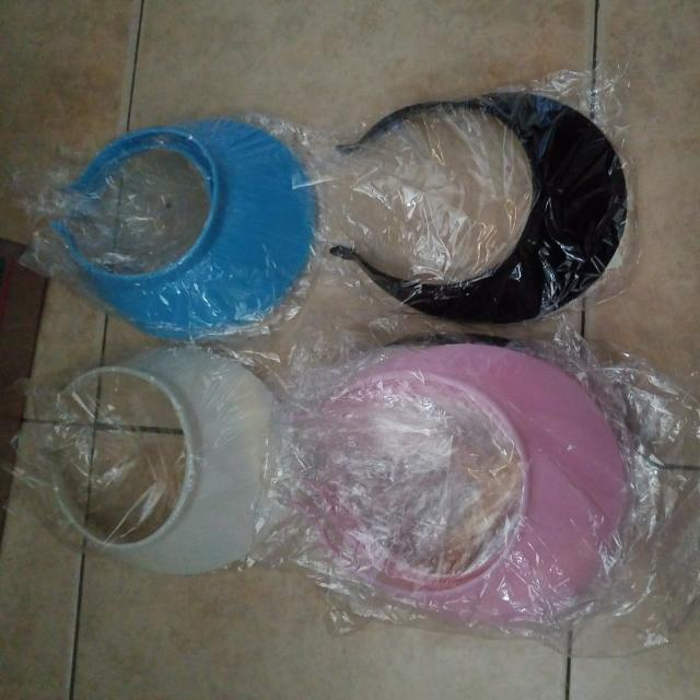 SELLING BLACK BLUE WHITE PINK VISORS NEW EACH ONE $1.00