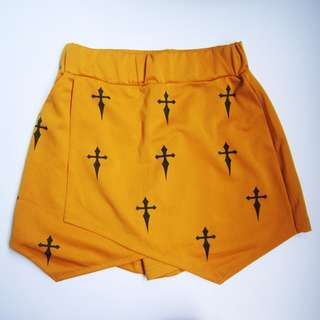 Mustard origami shorts with Cross details