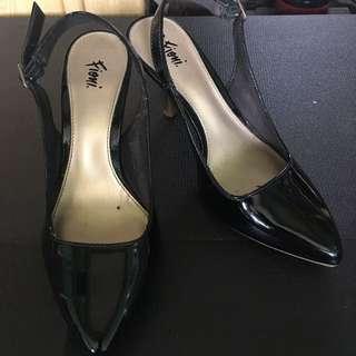 Black mid-heel slingback sandals