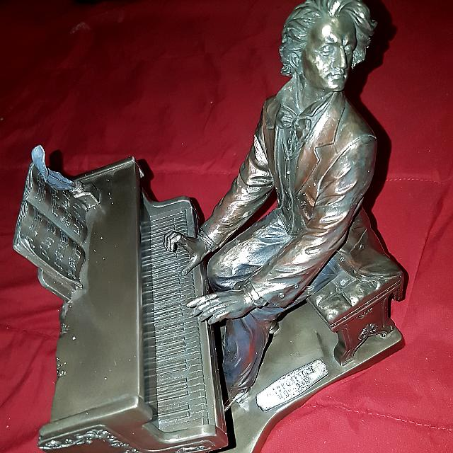 A Great Antique Piece Of A Piano Player