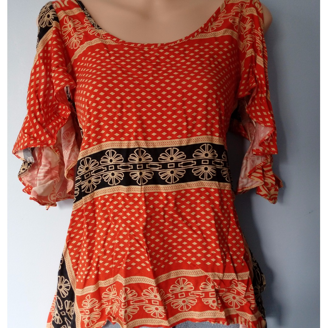 Bohemian style shirt with cut out shoulders
