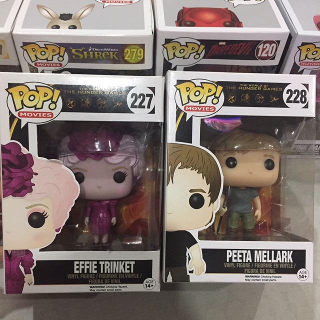 Funko Pop Peeta Mellark and Effie Trinket