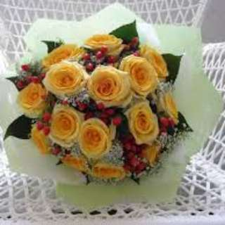 Yellow roses with small plants Bouquet