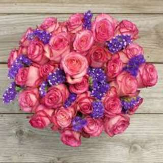 Beautiful mix of purple flower and roses Bouquet