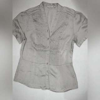 gray blouse by accent