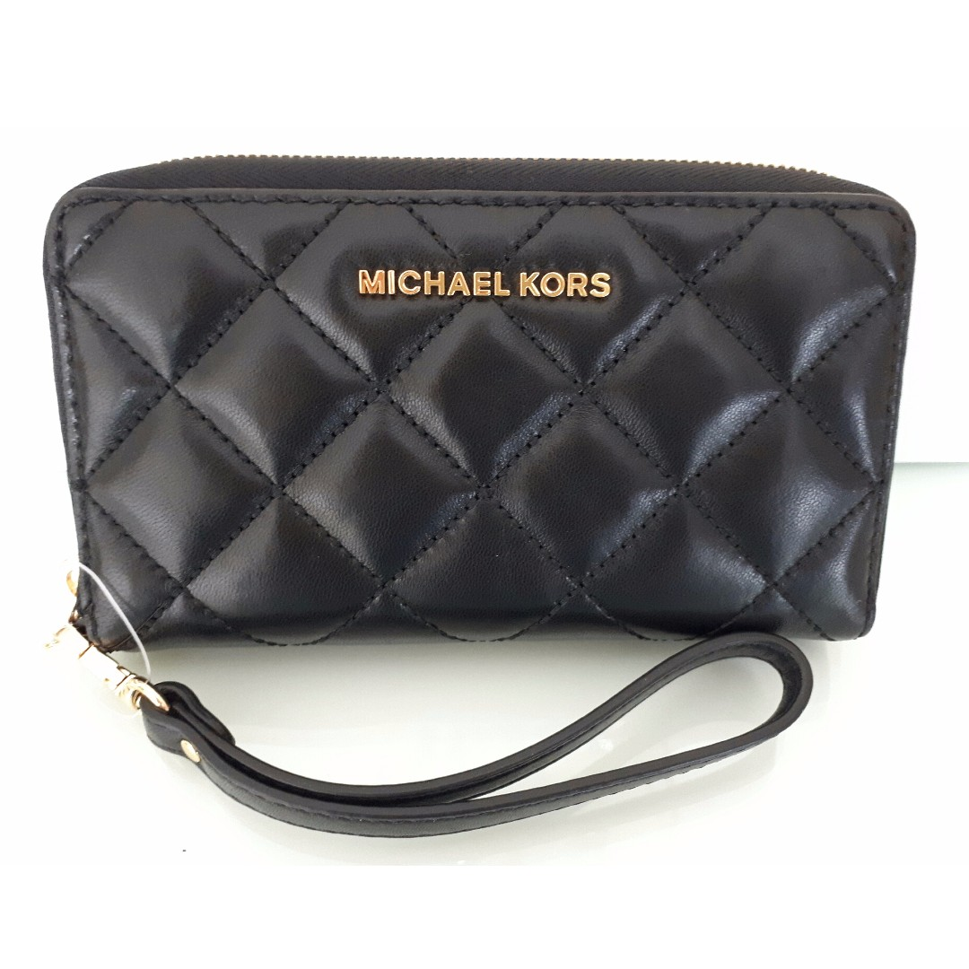 6cb59be1b450 Brand new Michael Kors Jet Set Travel Large Flat Multifunction ...