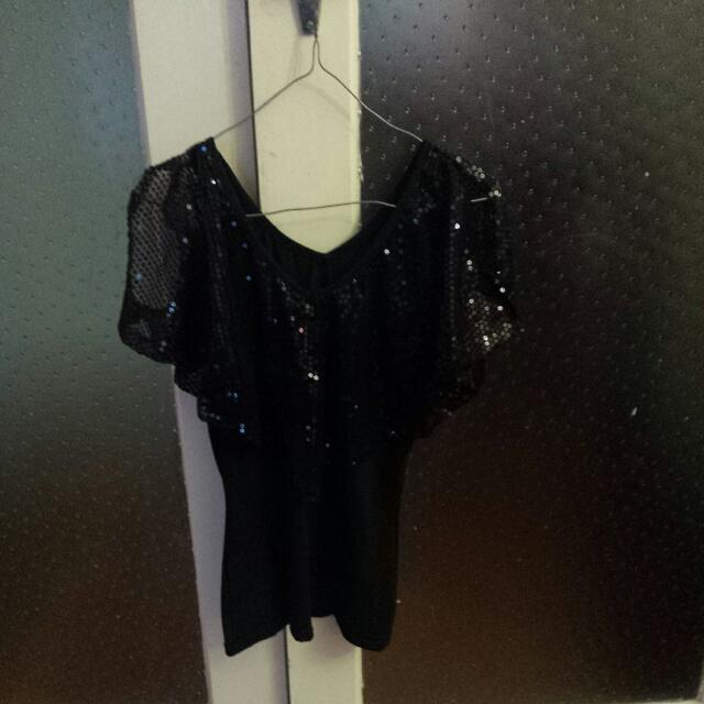 a black sequins top brand new large with postage 28.50