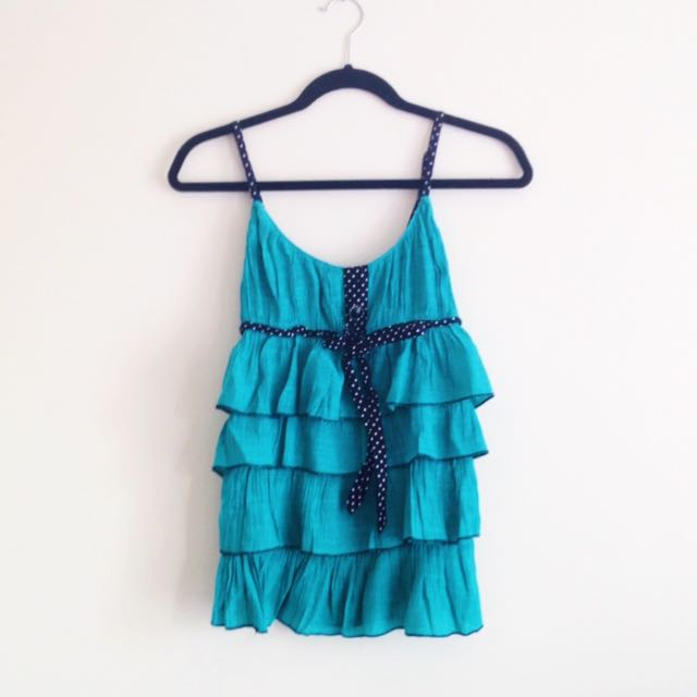 Teal ruffle tank top with black and white polka dot button detailing and tiers tiered girly layers