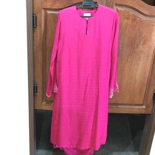 Baju kurung in bright pink