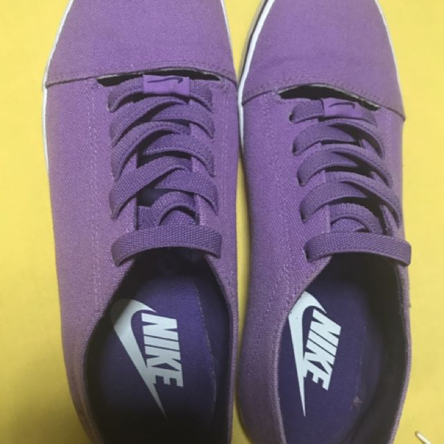 Authentic Nike Purple slip-ons