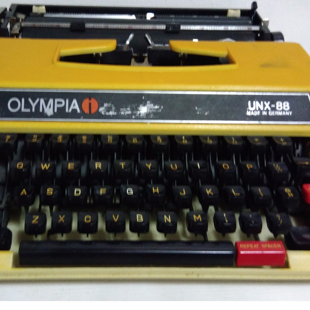 AUTHENTIC Olympia UNX 88 Portable Manual Typewriter (with original case)