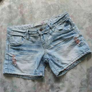 tattered denim shorts