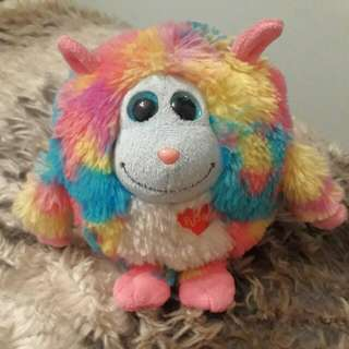 plush toy with rainbow fur