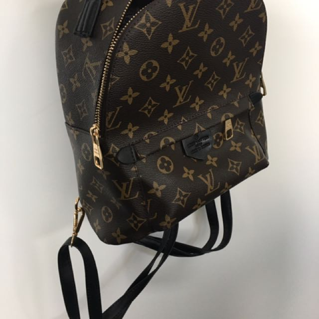 Brown Black Leather backpack LV