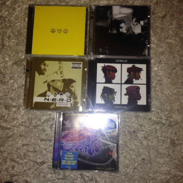 CDs (Gorillaz, Raury, Sam Smith, Panic! at the Disco, N.E.R.D)