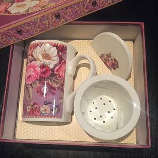 Tea Cup And Strainer Set