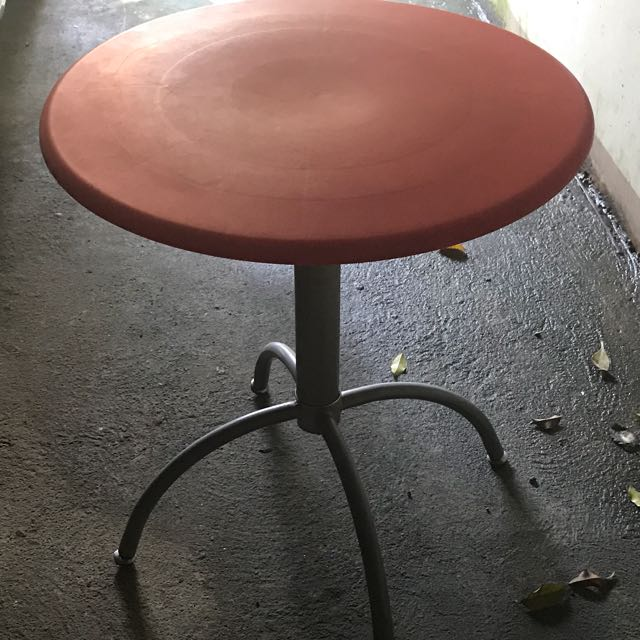 Red Plastic And Metal Round Table