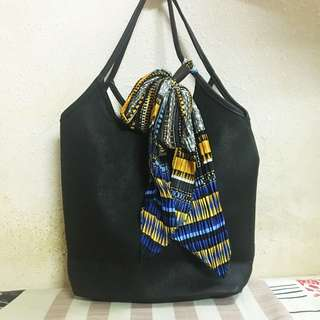 Bag with fanciful scarf