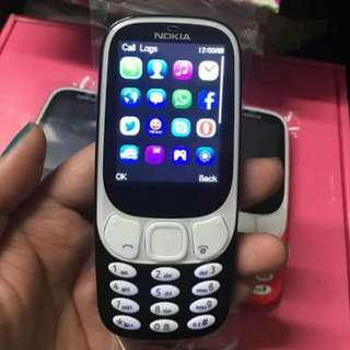 3310 FINLAND with facebook yahoo messenger and watzupp dual sim with memory card slot available color black  navy blu red light blue