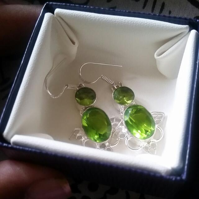 Brand New 925 Sterling Silver Peridot earrings. August birthstone