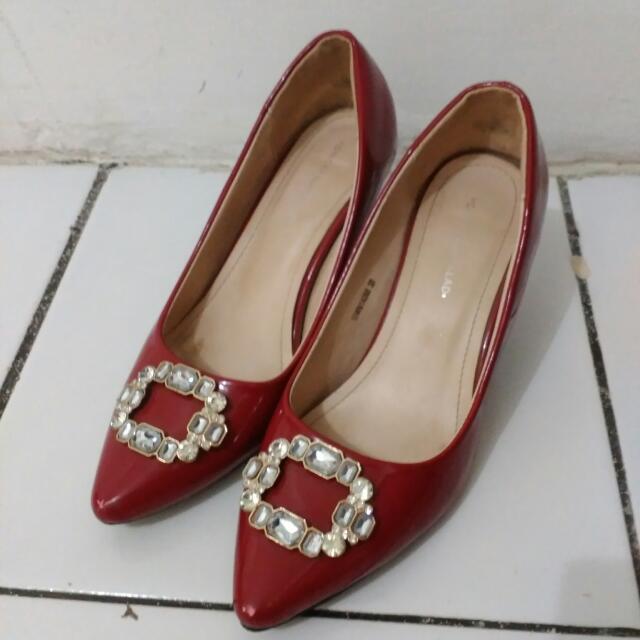 Red heels brand Yongki Komaladi