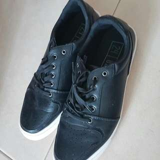 Used synthetic leather sneaker