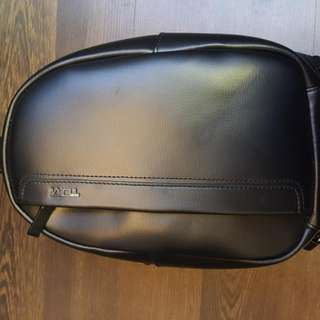 Tumi Leather Sling Bag
