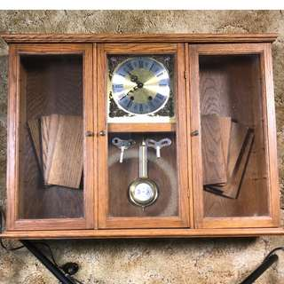 Antique wall clock and shelving piece.