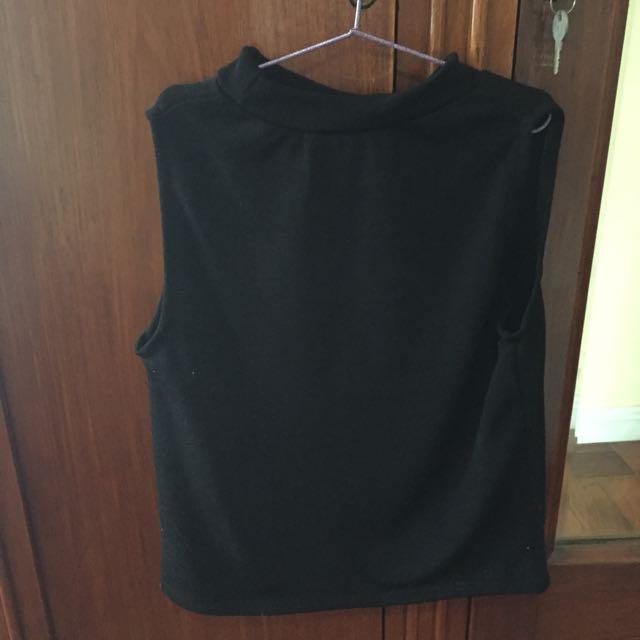 Black Sleeveless Turtleneck Top