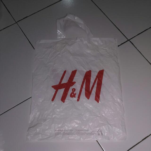 Plastik Baju Hnm
