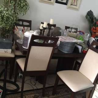 DINING ROOM SET SEATS UP TO 8. ADJUSTABLE TO 6 SEATS