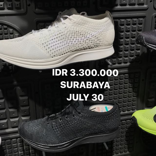 NIKE FLYKNIT RACER BLACK AND WHITE
