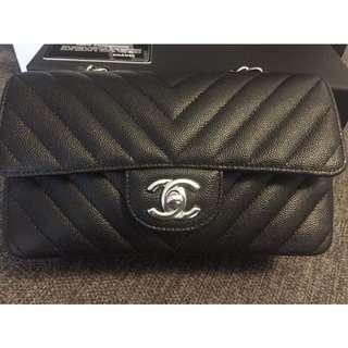 Authentic CHANEL Black Chevron Caviar Rectangular Mini Flap Bag