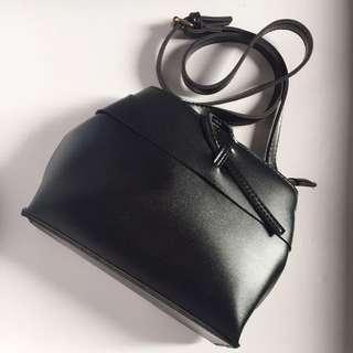 黑色打結造型包