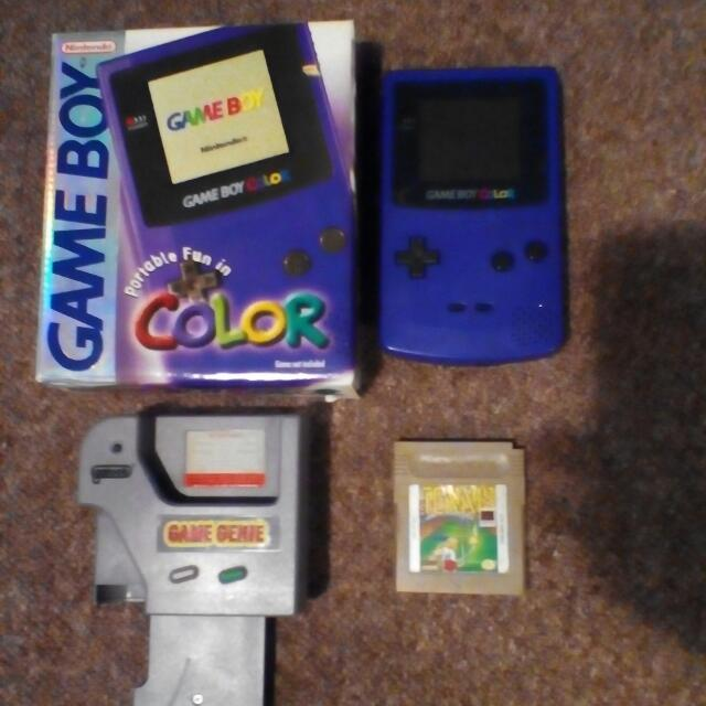 Gameboy Colour And Game genie Also Two Games.