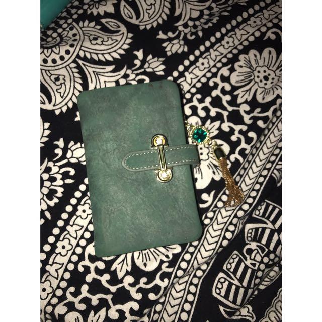 Small green wallet / matte suede material w/ tassel pendant