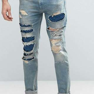 ASOS skinny jeans with mega rips