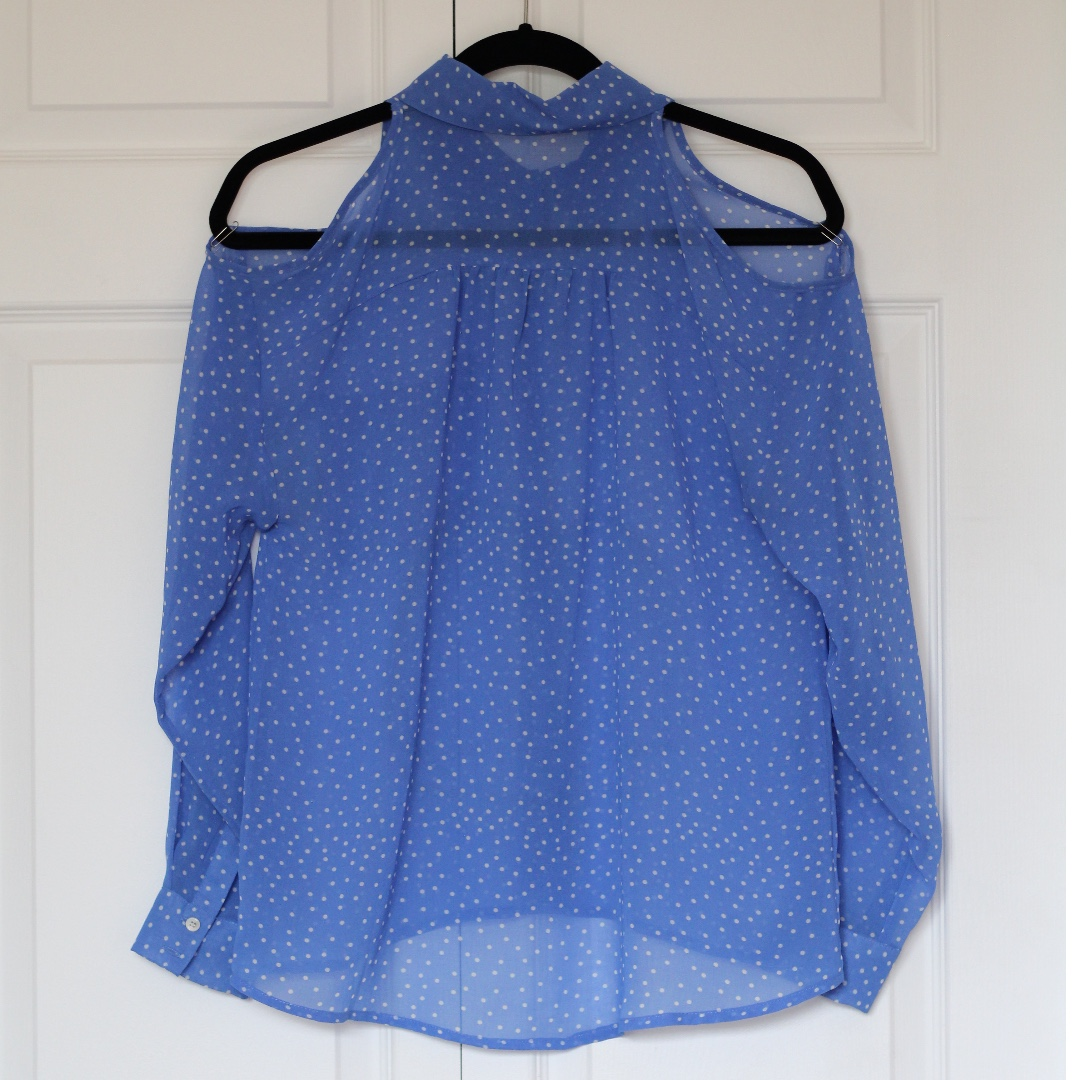 Blue w/ white polka dot sheer blouse with shoulder cut out