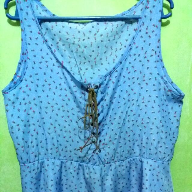 blue sleeveless top with rose details
