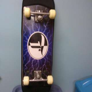 BRAND NEW SKATEBOARD WITH MURAL AND GLOSS FINISH, CARRY CASE ALSO