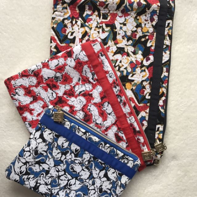 Authentic Carolina Herrera Travel Pouches