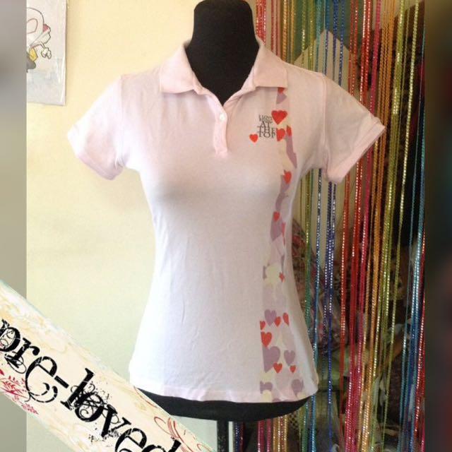Pale pink polo shirt w/ print