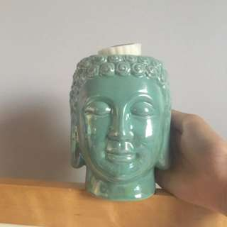 Buddha Head Candle melting statue