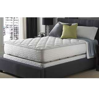 Queen sized pillow-top mattress with base