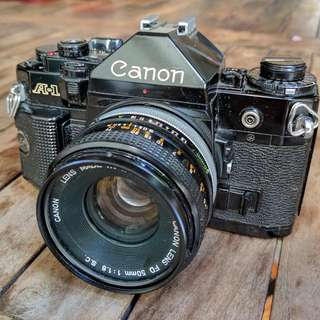 Canon A1 SLR Film Camera w/ 50mm F/1.8 S.C. Lens