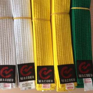 Martial Arts Wacoku Brand White And Yellow Belts For Only $1.80 Each.