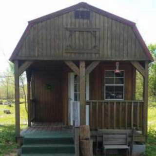 12x32 lofted barn-style cabin with built on porch