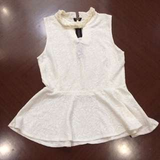 Sleeveless Peplum White Top