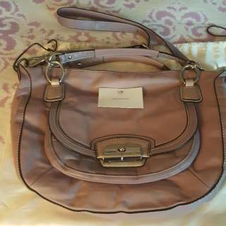 Authentic Coach Handbag with sling cum with dustbag